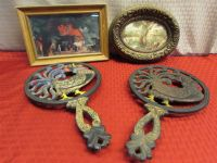 TWO VINTAGE CAST IRON ROOSTER TRIVETS & TWO WONDERFUL FRAMED PIECES  OF ART