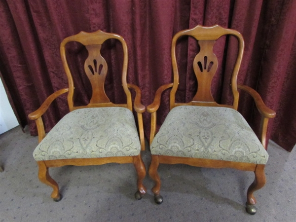 lot detail another pair of rolling dining room chairs