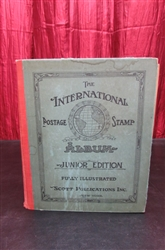 VINTAGE 1943 SCOTTS INTERNATIONAL POSTAGE STAMP ALBUM WITH LOADS OF STAMPS MOUNTED INSIDE